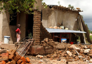 A boy looks on at a family home destroyed by floods following Cyclone Idai in Chimanimani district, Zimbabwe, on March 18, 2019. Photo by Philimon Bulawayo/Reuters