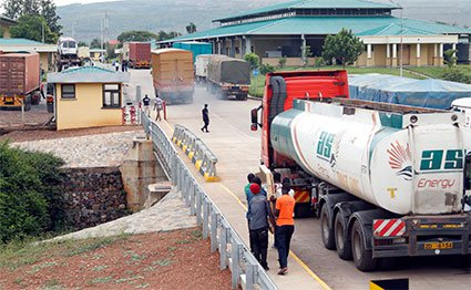 Trucks at approach the Kagitumba border.