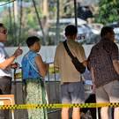 Thailand's Prime Minister Prayuth Chan-ocha, second left, waits in a line to cast his vote (Gemunu Amarasinghe/AP)