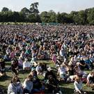 People gather for a vigil in Hagley Park (Mark Baker/AP)