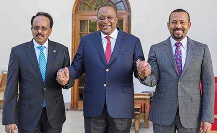 Somalian President Abdullahi Mohamed (left),