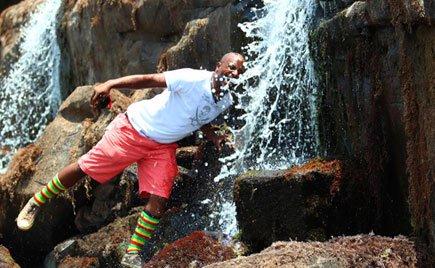 Radio and television star Gaetano Kagwa poses