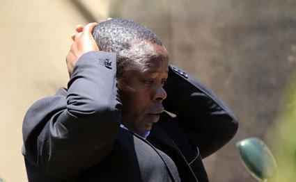 Jonathan Moi mourners