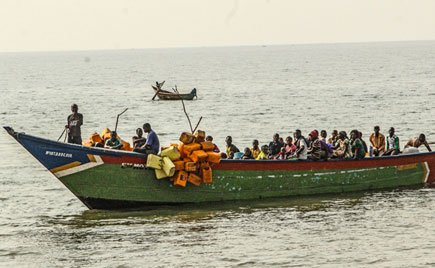 Overloaded.  An overloaded boat sails on Lake