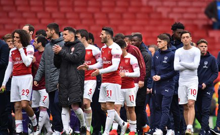 Arsenal's players parade on the pitch after the