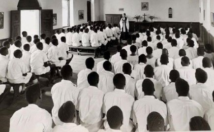Young boys attend a pre-baptism class at