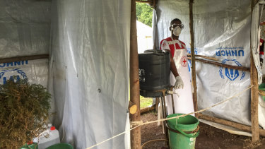 An Ebola screening checkpoint at the Bunagana crossing between Congo and Uganda. People crossing the border have their feet and hands washed with a chlorine solution. They also have have their temperature taken.