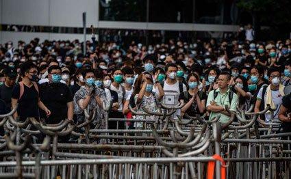Hong Kong stocks tumble as city hit by protests