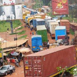 Cargo trucks parked in the no man's land at Uganda- Rwanda border