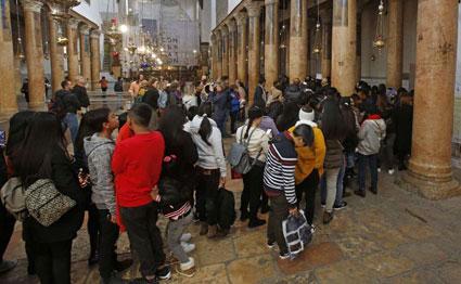 At Christmas, Bethlehem says denied full gifts of tourism