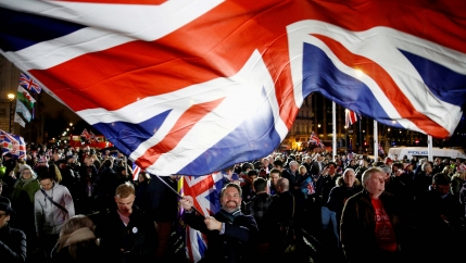 A man waves a British flag on Brexit day in London, Britain, on Jan. 31, 2020.