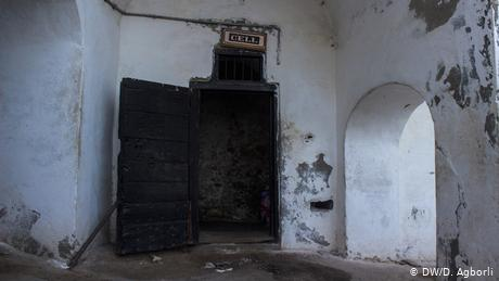 View of the entry to the condemned cells showing the dark room beyond (DW/D. Agborli)